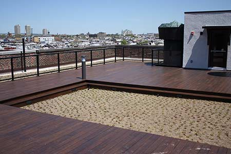 Northeast view of rooftop deck constructed with dasso.XTR fused bamboo decking