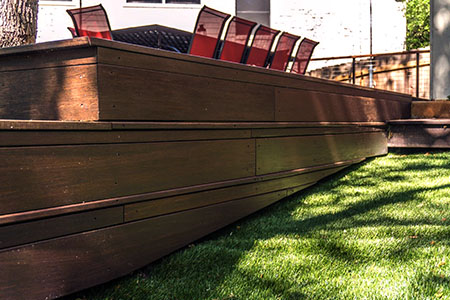 With the help of DX2 Construction, she built a hardwood deck with dassoXTR fused bamboo products
