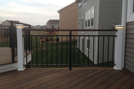 Illuminated railings surround deck constructed with dasso.XTR fused bamboo decking