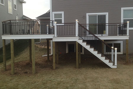 View from backyard of private deck constructed with dasso.XTR fused bamboo decking