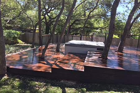 Built with dassoXTR, a hardwood decking product made of fused bamboo, the deck cascades down to a stone patio with fire pit. Less expensive than some tropical hardwoods, dassoXTR is 100% sustainable and will last for decades.