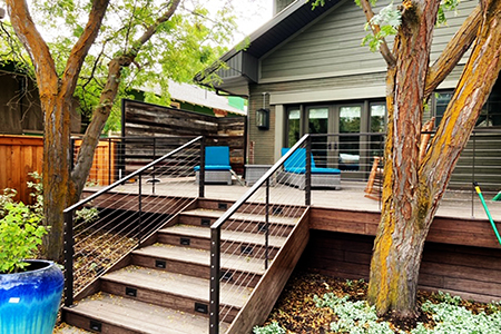 the deck used Classic Expresso decking with 1x8 lumber used for trim, design built by A1-decks with BMC as a dealer